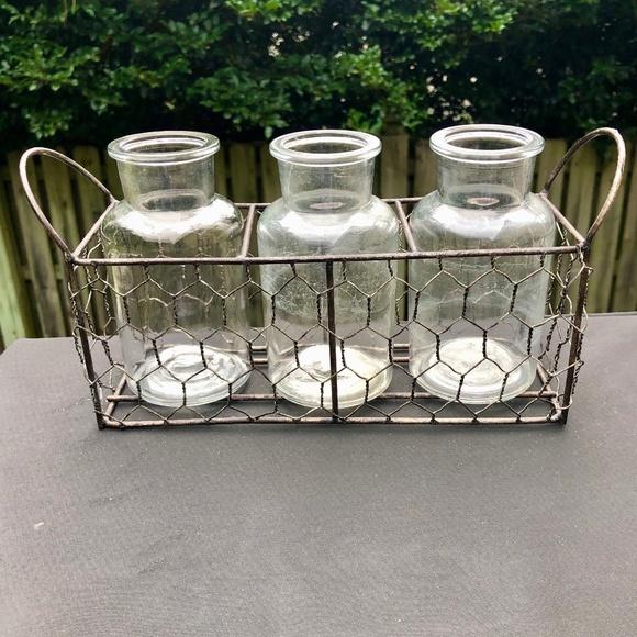 Vintage glass bottle set in wire holder